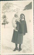 Photograph 1930's Nun Holding A Baby Swiss alps in the Snow