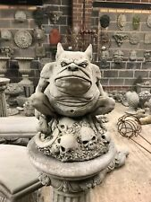 Gargoyle sat on skulls stone garden ornament gremlin statue gothic long tail