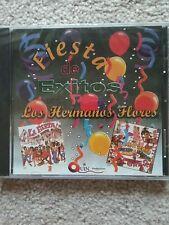 FIESTA DE EXITOS CON LOS HERMANOS FLORES A HARD TO FIND CD