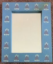 1970s Vintage country blue frame mirror with hand stenciled pineapple design.