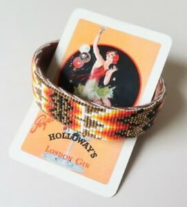 Hand Crafted 1.8cm Wide Leather Backed Orange, Black & Gold Glass Bead Bangle