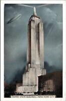 1930s LUMITONE Empire State Building Blimp AIrship Zeppelin Postcard CR