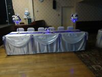 IVORY/CREAM SWAGS FOR TOP TABLE DECORATED WITH PURPLE/CREAM FLOWERS