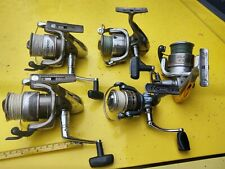 4 Shimano and 1 pflueger used spinning.reels
