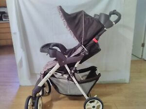 Graco Stroller walk behind with built in cupholders