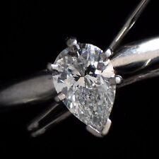 0.61 Carat Pear Shape F Color VVS2 Solitaire Engagement Ring Set In Platinum