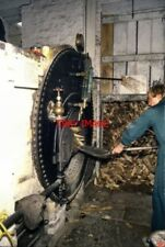 PHOTO  1988 STOKING THE BOILER COMBE SAW MILL LONG HANBOROUGH OXFORDSHIRE THIS W