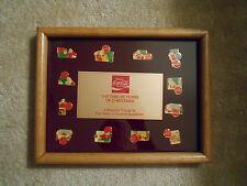 Coca-Cola 12 Years of Christmas Haddon Sundblom Santa Pin Set