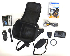 Zeikos camera bag (has internal partition), cleaning kit, camera strap, tripod