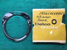 1956 Chevrolet Belair NOS headlight bezel door 5947173