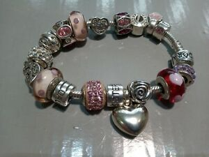 Silver pandora bracelet with approx 18 charms, total weight 58gms.