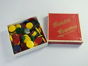 Vintage Box of Galalith Plastic Game Counters - Four Colours