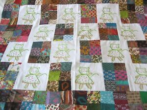 """Machine sewing patchwork and embroidered  handmade size 44""""x  52"""" quilt top"""