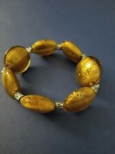 NEW, OVAL AMBER BEADED BRACELET Stretches for multiple sizes