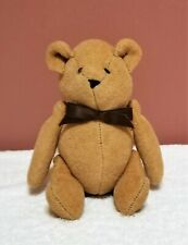 Vintage Winnie The Pooh Bear with button joints.  Honey colored felt. No tags.