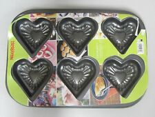 Molde horno a 6 formas forma corazón con adornos sul fondo 26 cm antiadherente