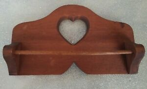Vintage brown wooden towel rack with heart cutout