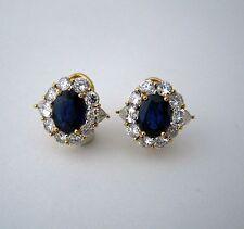 18 kt Two Tone Italian made Earrings with Ceylon Sapphire 10x7.5 diamonds around