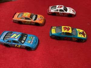 4 VINTAGE RARE NASCAR 1/64 muppets woody looney tunes racing for kids diecast