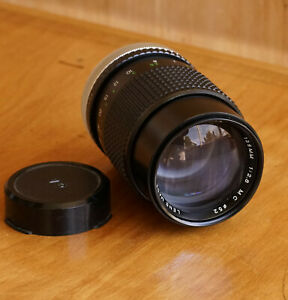 Cosina MC 135mm f2.8 lens Canon FD Mount Retractable Hood Excellent