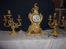 Garniture pendule et chandeliers bronze dore style Louis xv fonctionne sonne