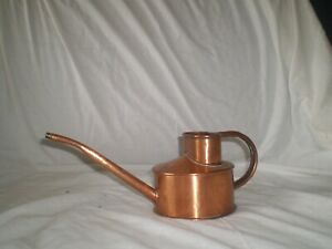 A copper internal watering can