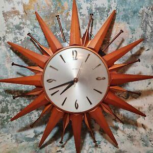 Vintage METAMAC Battery Sunburst / starburst Wall Clock WORKING teak and metal