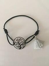Bracelet arbre de vie noir et blanc sur cordon élastique noir avec pompon gris