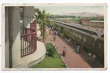 1910 Postcard showing Train Santa Fe Limited at Needles CA Indians selling Beads