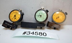 Lot of Three Tenths dial indicators (Inv.34580)