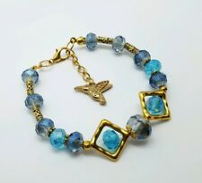 Blue and Gold , bracelet with gold charm.