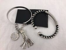 """Guess set of 2 silver tone """"Guess""""~2 bracelets,not your everyone's piece."""
