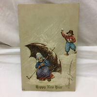 Vtg Embossed Postcard A Happy New Year Greeting Dutch Boy Girl Kids Snow Scene