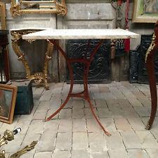 guéridon tripode en fonte de fer ,patine originale , pieds griffe . XIX siècle .