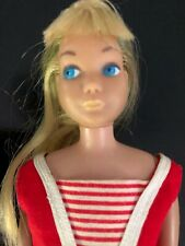 Vintage blond bend leg skipper with  original headband and swimsuit.
