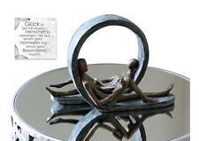 79291 Escultura Tiempo de espera de poli · acabado en bronce gris Base Altura
