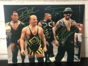 WWE Autographed 8x10 The Rock Owen Hart Godfather D-Lo Brown COA