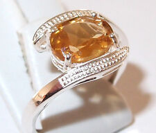 Oval Citrine twist solitaire in rhodium plated Sterling Silver, 1.75ct. Size M.