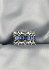 18KT White Gold,Sapphire and Diamond Band Channel Set with Emerald cut Sapphires