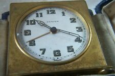 A VINTAGE ZENITH TRAVEL ALARM CLOCK AND CASE NEEDS A SERVICE c.1910