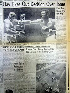 1963 display newspaper CASSIUS CLAY wins boxing match before SONNY LISTON fight