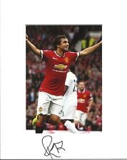 10 x 8 inch mount personally signed by Rafael Da Silva of Manchester United.