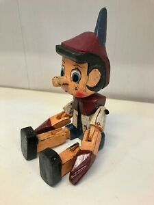 handmade painted wooden Pinocchio sitting puppet shelf hinge gift child's room