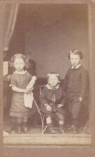 ANTIQUE CDV PHOTO. 1880. SMALL GIRL HOLDING DOLL WITH 2 BROTHERS. NO STUDIO