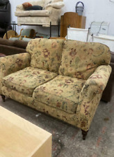 Floral two seater fabric sofa