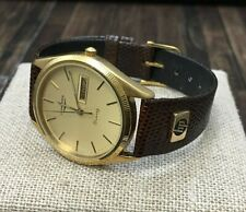 """Men's Longines quartz watch with brown leather band with 14KY """"HP"""" logo on band"""