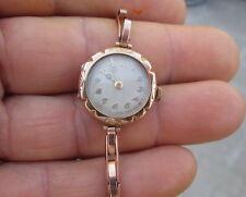 Orologio oro 14 kt. inglese con bracciale a molla. Epoca primissimi '900. funzi