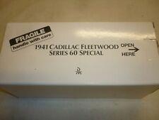 A Danbury mint model of a 1941 Cadillac Fleetwood series 60 special.  Boxed