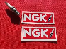 Pair of NGK spark plugs red stickers small