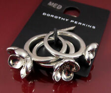 DOROTHY PERKINS. SET OF 3 SILVER FLOWER STATEMENT RINGS. UK SIZE P. US 7½ (15)